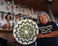 "Today pictures from all over the world arrive frequently in the morning mail. Each image shows a tee shirt bought at Second Mesa on someone in a remote and exotic spot of the world. The tee shirt that travels she said. One Day she just pinned ""Don't Worry Be Hopi"" and it has gone all around the globe said Janice Quotskuyvo Day. She and her husband, Joseph, run TSAKURSHOVI, a craft supply show, that sells to tourists, barters with artist for a combination of supplies and cash."