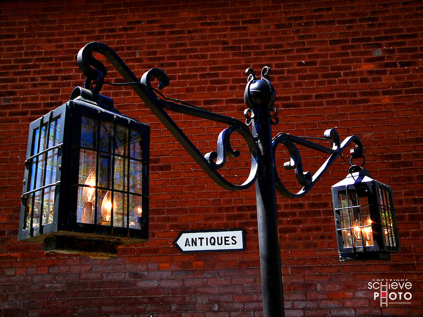 An antique lamp outside of an antique store.