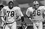 Oakland Raiders training camp August 10, 1982 at El Rancho Tropicana, Santa Rosa, California.   Oakland Raiders tackle Art Shell (78) and tight end Todd Christensen (46).