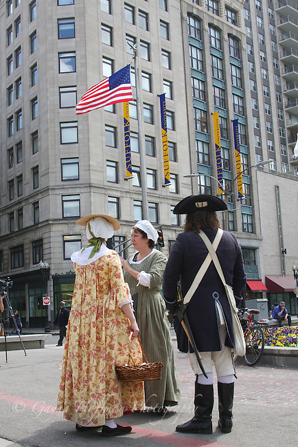 American flag, Colonial costumed Freedom Trail tour guides. Boston, MA, women, man,city, tourism, vertical, New England, history, travel