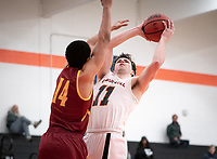 #11 Kyle Dosa<br /> The Occidental College men's basketball team plays against Claremont-Mudd-Scripps on February 12, 2020 in Rush Gym. Oxy won 58-49.<br /> (Photo by Marc Campos, Occidental College Photographer)