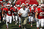 Madison, Wisconsin - 9/6/2003.  University of Wisconsin head coach Barry Alvarez leads his team onto the field before the Akron game at Camp Randall. Wisconsin beat Akron 48-31. (Photo by David Stluka).