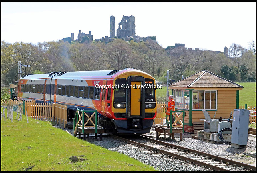 BNPS.co.uk (01202 558833)<br /> Pic: AndrewWright/BNPS<br /> <br /> The first train makes its way along the extension.<br /> <br /> A public train service is to run on a railway line ripped up in the 'Beeching Axe' thanks to an army of volunteers who have spent 45 years painstakingly rebuilding it. From next month timetabled passenger trains will operate on a daily basis from the mainline down to Swanage in Dorset.The Victorian town was effectively cut off from the rail network in 1972 after Dr Richard Beeching, a government railway advisor, recommended it be one of hundreds of loss-making rural lines axed.Since then hundreds of people have restored the track which has been upgraded to meet today's safety standards.