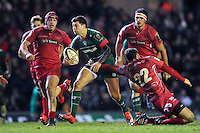 Ben Youngs of Leicester Tigers takes on the Scarlets defence. European Rugby Champions Cup match, between Leicester Tigers and the Scarlets on January 16, 2015 at Welford Road in Leicester, England. Photo by: Patrick Khachfe / JMP