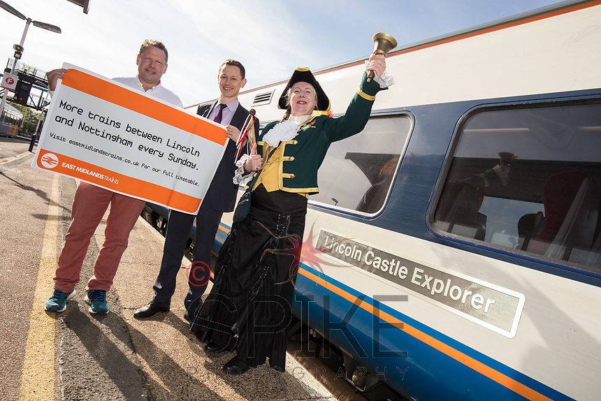 From left are Lincoln MP Karl McCartney, Amy Lawrence Bowman of East Midlands Trains and Lincoln Town Crier Karen Crow at the launch of the new Lincoln to Nottingham train timetable