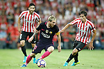 Athletic de Bilbao's Eneko Boveda (l) and Ander Iturraspe (r) and FC Barcelona's Leo Messi during La Liga match. August 28,2016. (ALTERPHOTOS/Acero)