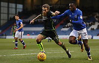 Oldham Athletic's Temitope Obadeyi (right) vies for possession with Bristol Rovers' Stuart Sinclair (left) during the Sky Bet League 1 match between Oldham Athletic and Bristol Rovers at Boundary Park, Oldham, England on 30 December 2017. Photo by Juel Miah / PRiME Media Images.
