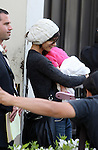 4-1-09. .Katie Holmes leaving the Grove shopping center with her baby Suri in Los angeles California ..  AbilityFilms@yahoo.com.805-427-3519.www.AbilityFilms.com