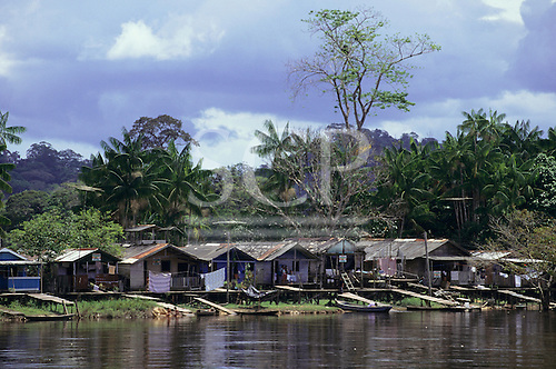 Serra do Navio, Brazil. Neat settlement of Caboclo stilt houses on the riverbank. Amazon, Amapa State.
