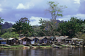 Serra do Navio, Brazil. Neat settlement of Caboclo stilt houses on the riverbank. Amazon, Amapa State.