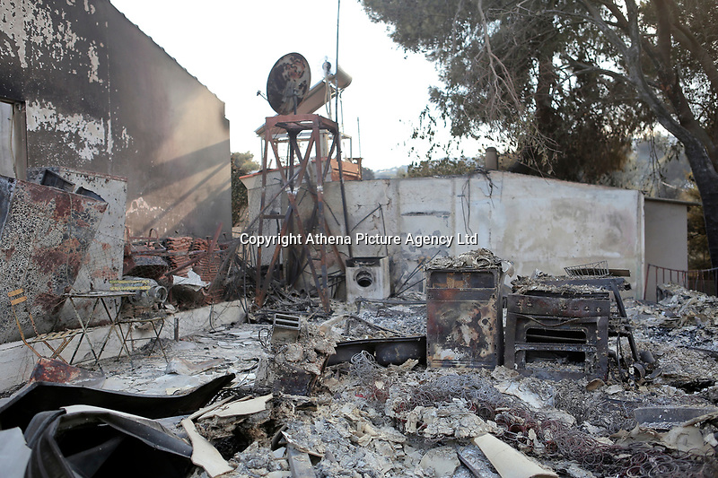 Pictured: One f the gutted homes in the aftermath of the forest fire which has claimed dozens of lives in the Mati area of Rafina, Greece. Wednesday 25 July 2018<br /> Re: Deaths caused by wild forest fires throughout Greece.