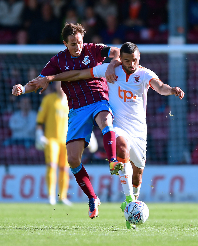 Blackpool's Colin Daniel vies for possession with Scunthorpe United's Josh Morris<br /> <br /> Photographer Chris Vaughan/CameraSport<br /> <br /> The EFL Sky Bet League One - Scunthorpe United v Blackpool - Saturday 9th September 2017 - Glanford Park - Scunthorpe<br /> <br /> World Copyright &copy; 2017 CameraSport. All rights reserved. 43 Linden Ave. Countesthorpe. Leicester. England. LE8 5PG - Tel: +44 (0) 116 277 4147 - admin@camerasport.com - www.camerasport.com