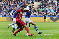 (L-R) Luciano Narsingh of Swansea City takes a cross while challenged by Morgan Fox of Sheffield Wednesday during The Emirates FA Cup Fifth Round match between Sheffield Wednesday and Swansea City at Hillsborough, Sheffield, England, UK. Saturday 17 February 2018