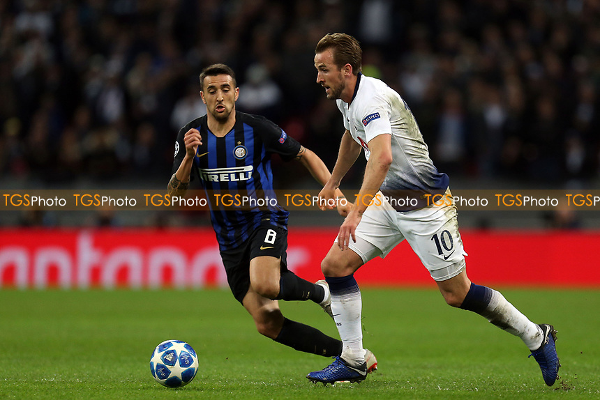 Harry Kane of Tottenham Hotspur and Matias Vecino of Internazionale during Tottenham Hotspur vs Inter Milan, UEFA Champions League Football at Wembley Stadium on 28th November 2018