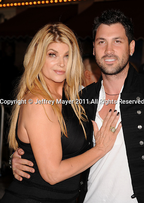 "ANAHEIM, CA - MAY 07: Kirstie Alley and Maksim Chmerkovskiy arrive to the ""Pirates Of The Caribbean: On Stranger Tides"" World Premiere at Disneyland on May 7, 2011 in Anaheim, United States."
