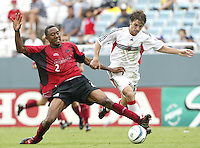 26 June 2004:  DC United Bobby Convey battles for the ball against Dallas Burn Defender Cory Gibbs at Cotton Bowl in Dallas, Texas.   DC United and Dallas Burn are tied 1-1 after the game.   Credit: Michael Pimentel / ISI