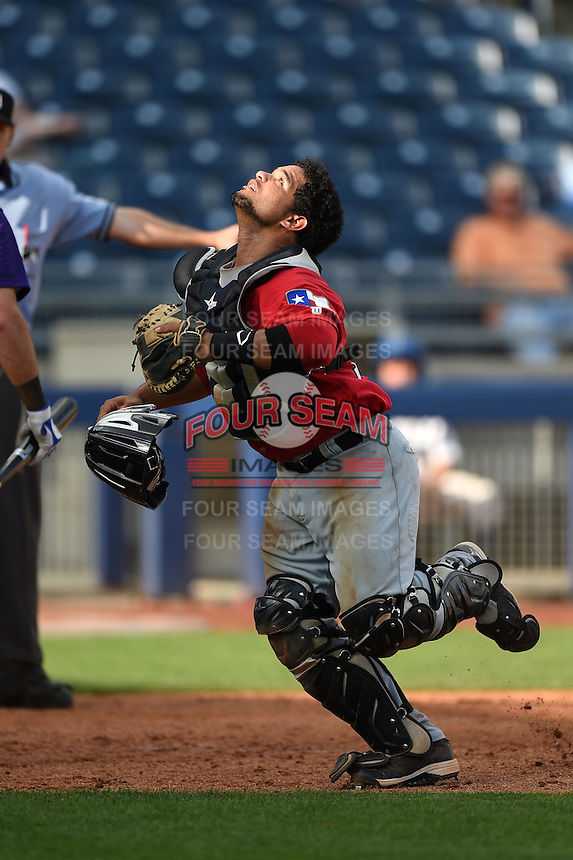 Frisco Rough Riders catcher Tomas Telis (13) looks for a pop up foul ball during the first game of a doubleheader against the Tulsa Drillers on May 29, 2014 at ONEOK Field in Tulsa, Oklahoma.  Frisco defeated Tulsa 13-4.  (Mike Janes/Four Seam Images)