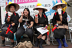 Women from Hyogo dressed in black yukata to mourn deaths from nuclear contamination protest outside METI (Ministry of Economy, Trade and Industry) in Tokyo, Japan. Friday June 29th 2012. About 400 protesters campaigned the restarting of the Oi nuclear power-station and the policy of Prime-Minister Noda to restart Japan's nuclear power generation programme which has been stalled since the earthquake and tsunami of March 11th 2011 caused meltdown and radiation leaks at the Fukushima Daichi Nuclear power-plant.