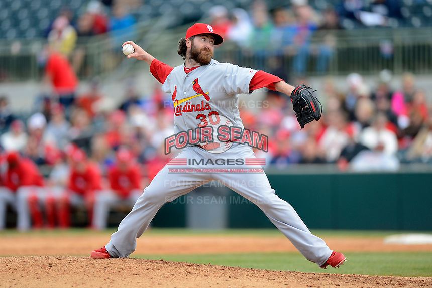 St. Louis Cardinals pitcher Jason Motte #30 during a Spring Training game against the Houston Astros at Osceola County Stadium on March 1, 2013 in Kissimmee, Florida.  The game ended in a tie at 8-8.  (Mike Janes/Four Seam Images)