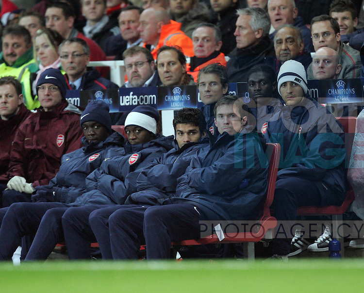 Arsenal's Jens Lehmann watches form the bench