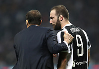 Calcio, Serie A: Inter - Juventus, Milano, stadio Giuseppe Meazza (San Siro), 28 aprile 2018.<br /> Juventus' coach Massimiliano Allegri (l) speaks with Gonzalo Higuain (r) during the Italian Serie A football match between Inter Milan and Juventus at Giuseppe Meazza (San Siro) stadium, April 28, 2018.<br /> UPDATE IMAGES PRESS/Isabella Bonotto