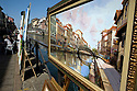 View of Naviglio Grande (canal), a paint by Aldo Zaccarelli, showed at exibition Arte sul Naviglio Grande (Art on Naviglio Grande), Milan, May, 2011. In the background the same bridge of the paint. Arte sul Naviglio Grande is an exhibition in the open air along Naviglio Grande. © Carlo Cerchioli..Un quadro di una veduta del Naviglio Grande opera di Aldo Zuccarelli in mostra durante l'esposizione all'aria aperta Arte sul Naviglio, Milano, Maggio 2011. Sullo sfondo lo stesso ponte riprodotto nel quadro.
