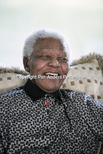 MAPUTO, MOZAMBIQUE JUNE 14: Former President Nelson Mandela of South Africa relaxes while on holiday on June 14, 2006 in Maputo, Mozambique. He is retired and takes time off with his wife Graca Machel in her residence in central Maputo. Mr. Mandela turns 88 on July 18, 2006. The ANC freedom fighter spent 27 years in prison, and was released in 1990. He became President of South Africa after the first multiracial democratic elections in April 1994. Mr. Mandela retired after one term in 1999 and gave the leadership to the current president Mr. Thabo Mbeki. (Photo by Per-Anders Pettersson).