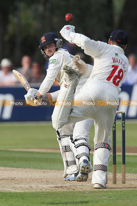 Jaik Mickleburgh of Essex sneaks the ball past Mark Wallace - Essex CCC vs Glamorgan CCC - LV County Championship Division Two Cricket at the Castle Park, Colchester - 16/08/12 - MANDATORY CREDIT: Gavin Ellis/TGSPHOTO - Self billing applies where appropriate - 0845 094 6026 - contact@tgsphoto.co.uk - NO UNPAID USE.