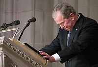 Former President George W. Bush becomes emotional as he speaks at the State Funeral for his father, former President George H.W. Bush, at the National Cathedral, Wednesday, Dec. 5, 2018, in Washington.<br /> Credit: Alex Brandon / Pool via CNP / MediaPunch
