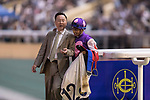 Trainer Almond Lee (L) and jockey Karis Teetan (R) and celebrate after the winning of the Jardine's Lookout Handicap on 29 March 2017, at Happy Valley Racecourse  in Hong Kong, China. Photo by Chris Wong / Power Sport Images