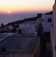The sun setting into the sea seen from the Greek island of Patmos