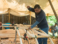 NWA Democrat-Gazette/BEN GOFF @NWABENGOFF<br /> Waiston Beaja lashes together joints on the outrigger Wednesday, May 9, 2018, while working on the Marshallese Korkor at the Shiloh Museum of Ozark History in Springdale. Master canoe builder Liton Beasa and his family, in partnership with the Shiloh Museum of Ozark History, began building the two-man Marshallese canoe called a KorKor April 14 and plan to display the finished canoe at the Little Craft Show Saturday in downtown Springdale.
