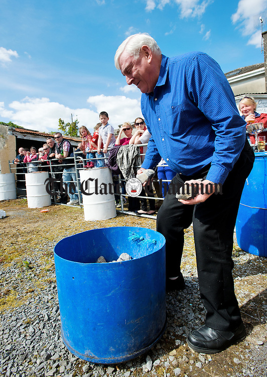 "TJ Moloney ""re-loads"" at the World Stone Throwing Championships in Corofin. Photograph by John Kelly."