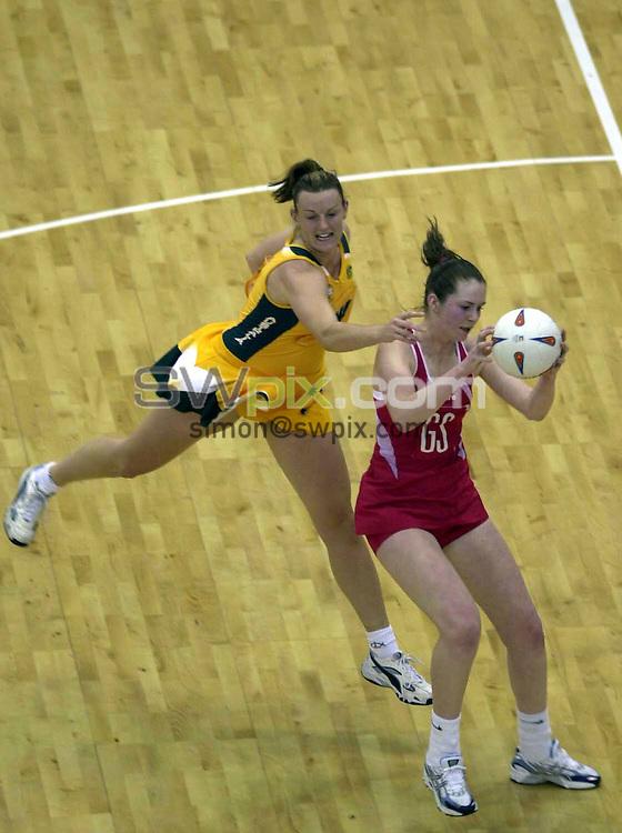 Pix: Simon Wilkinson/SWpix.com. International Netball. 2004 Test Series. England v Australia. NIA Birmingham. 20/03/04..COPYRIGHT PICTURE>>SIMON WILKINSON>>01943 608782>>..Englands Louisa Brownfield and Australias Bianca Chatfield