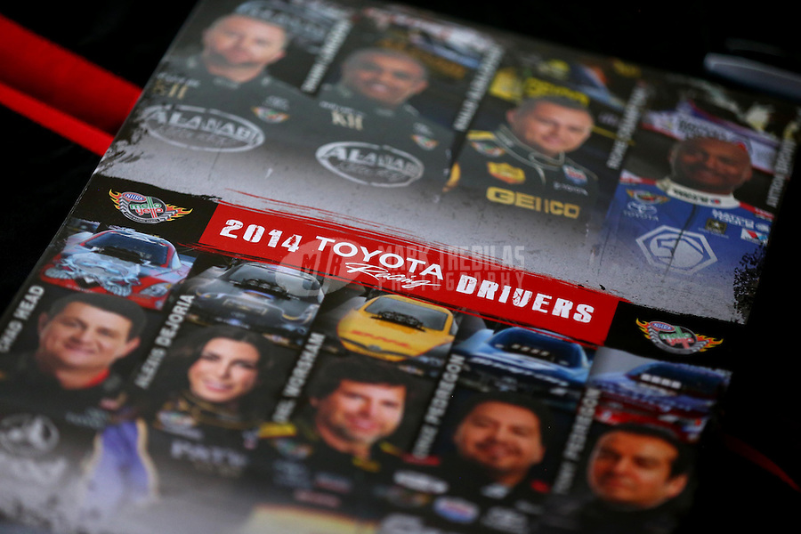 May 30, 2014; Englishtown, NJ, USA; Detailed view of an NHRA hero card with all of the Toyota Racing drivers during qualifying for the Summernationals at Raceway Park. Mandatory Credit: Mark J. Rebilas-