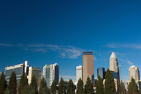 Wide-angle, horizontal photo of the Charlotte, NC skyline with lots of blue sky. Charlotte is North Carolina's largest city and the 20th-largest city in the United States.