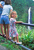 Young girl at Akaka Falls, Big island. The states longest waterfall.