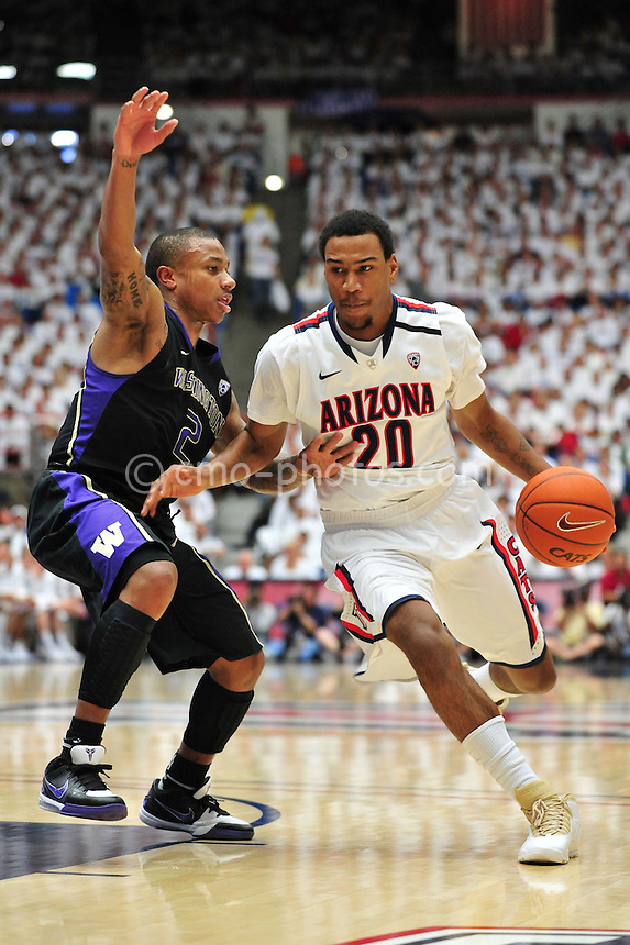Feb 19, 2011; Tucson, AZ, USA; Washington Huskies guard Isaiah Thomas (2) defends the dribble of Arizona Wildcats guard Jordin Mayes (20) in the 1st half of a game at the McKale Center.  The Wildcats won 87-86.
