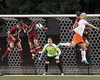 Corner kick action. Boston College goalkeeper Alex Kapp (1) encourages his teammates.Boston College (maroon) defeated Syracuse University (white/orange), 3-2, at Newton Campus Field, on October 8, 2013.