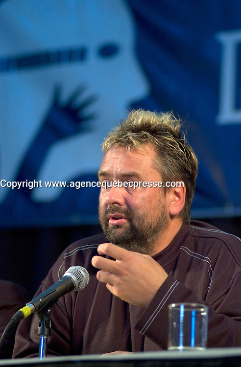 Aug 6 2002, Montreal, Quebec, Canada<br /> <br /> <br /> After beeing handed out a Grand Prize of The Americas Award,<br /> Luc Besson, French Film Maker and Producer(R),answer questions from the medias,<br />  at a press conference, Aug 23,  2002, in  Montreal, Quebec, Canada<br /> <br /> Besson directed many films including Leon, Nikita (Original version), the 5th Element,...<br /> <br /> <br /> Mandatory Credit: Photo by Pierre Roussel- Images Distribution. (&copy;) Copyright 2002 by Pierre Roussel <br /> <br /> NOTE : <br />  Nikon D-1 jpeg opened with Qimage icc profile, saved in Adobe 1998 RGB<br /> .Uncompressed  Uncropped  Original  size  file availble on request.