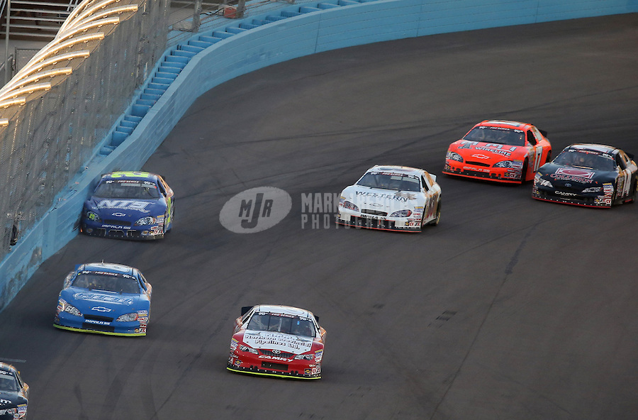 Mar. 2, 2013; Avondale, AZ, USA; NASCAR K&N Pro Series West driver Dallas Montes (29) hits the wall prior to being hit by Kelly Admiraal (83) during the Talking Stick Resort 60 at Phoenix International Raceway. Mandatory Credit: Mark J. Rebilas-