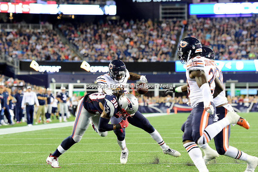Thursday, August 18 2016: Chicago Bears cornerback Tracy Porter (21) strips the ball from New England Patriots running back Brandon Bolden (38) during a pre-season NFL game between the Chicago Bears and the New England Patriots held at Gillette Stadium in Foxborough Massachusetts. The Patriots defeat the Bears 23-22 in regulation time. Eric Canha/Cal Sport Media