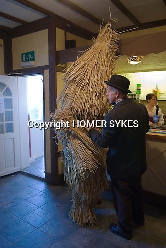 Straw Bear Festival. Whittlesea Whittlesey Cambridgeshire UK 2008. Straw Bear and handler in the George Hotel bar.