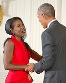 United States President Barack Obama presents the 2015 National Humanities Medal to Isabel Wilkerson, Journalist & Author of Atlanta, Georgia, during a ceremony in the East Room of the White House in Washington, DC on Thursday, September 22, 2016.<br /> Credit: Ron Sachs / CNP
