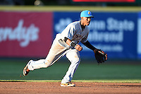 Akron RubberDucks shortstop Francisco Lindor (12) fields a ground ball during a game against the Erie SeaWolves on May 17, 2014 at Jerry Uht Park in Erie, Pennsylvania.  Erie defeated Akron 2-1.  (Mike Janes/Four Seam Images)