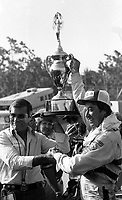 Harry Gant and Hal Needham celebrate after winning the Southern 500 at Darlingotn Raceway in Darlington, SC on September 2, 1984.  (Photo by Brian Cleary/www.bcpix.com