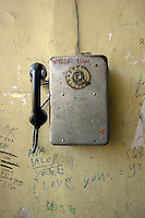 Graffiti surrounds an old public phone in Tbilisi...