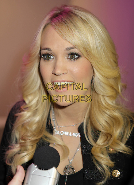 Carrie Underwood.attending the Country2Country concert, o2 Arena, Greewich, London, England. 17th March 2013.headshot portrait jacket silver necklaces black mouth open microphone  .CAP/ROS.©Steve Ross/Capital Pictures