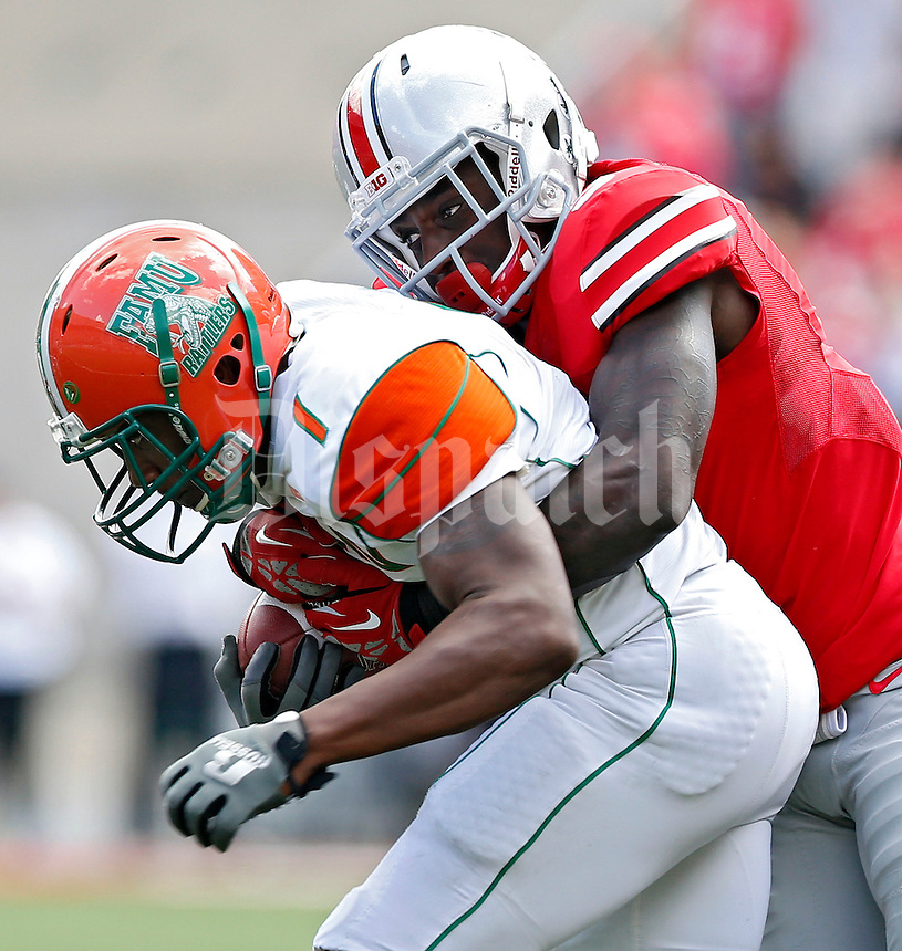 Ohio State Buckeyes defensive back Corey Brown (3) takes down Florida A&M Rattlers running back Al-Terek McBurse (1) in the 3rd quarter during their college football game at Ohio Stadium on September 21, 2013.  (Dispatch photo by Kyle Robertson)