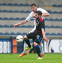 Raith Rovers' Calum Elliot and Caley's Graeme Shinnie challenge for the ball.